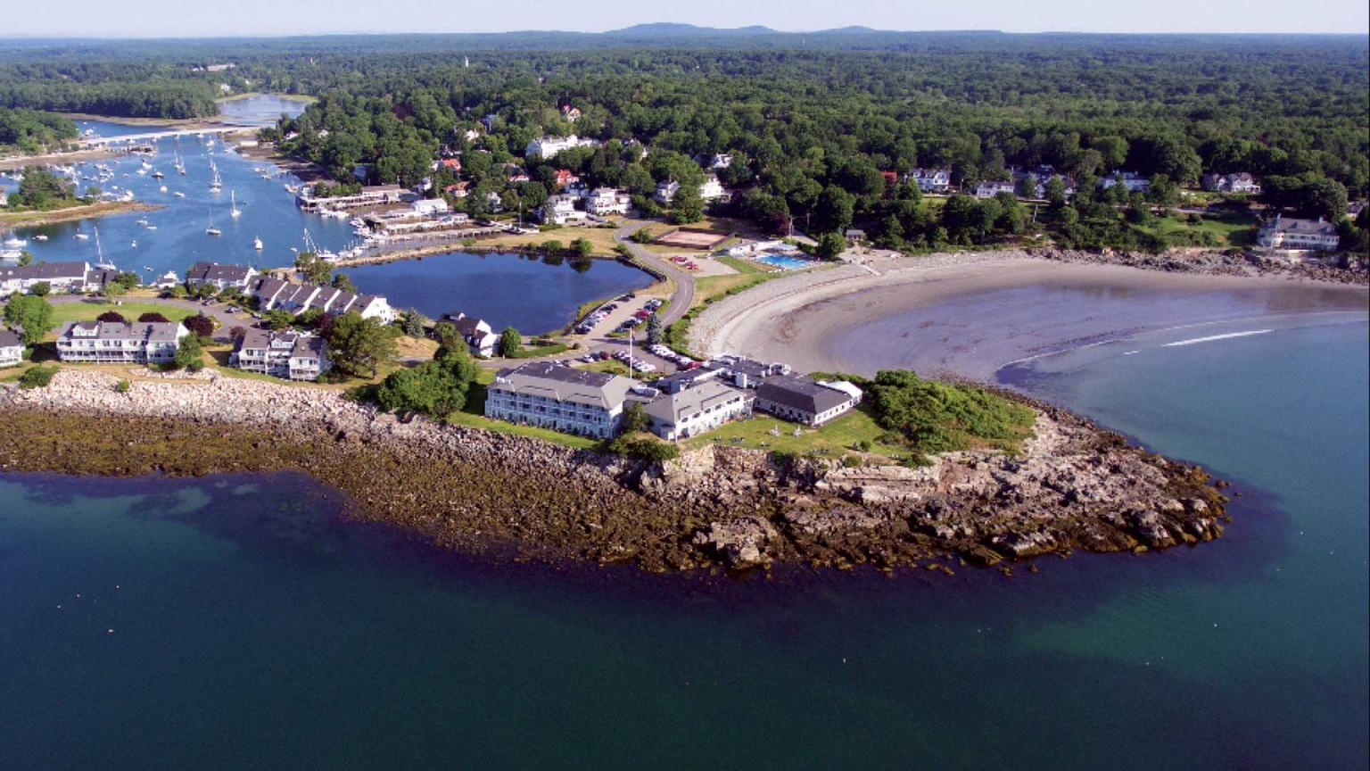 Stage Neck Inn sits on the point that is jutting into the Ocean. Along the left side is the York River connecting to York Harbor. To the right of the Inn is Harbor Beach and the Inn's outdoor pool and tennis club.