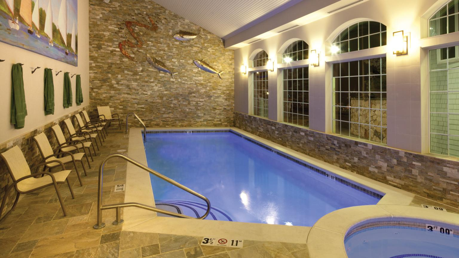 Stage Neck Inn Indoor pool and hot tub with evening lighting
